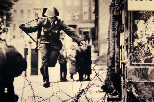 Peter Leibing's famous photograph of East German border guard Conrad Schumann legging it over the Berlin Wall